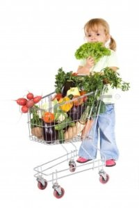ittle-girl-pushing-shopping-cart-filled-with-vegetables--isolated
