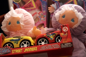 Toy cars and dolls